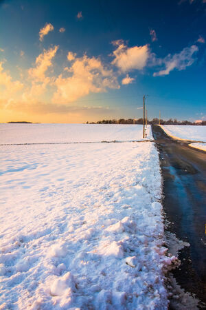 covered fields: Country road and snow covered fields at sunset, in rural York County, Pennsylvania.