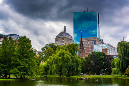 Pond in the Public Garden and buildings in Boston, Massachusetts.