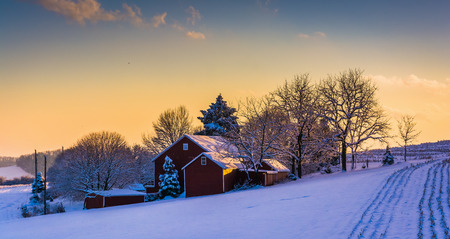winter: Winter view of a barn on a snow covered farm field at sunset, in rural York County, Pennsylvania. Editorial