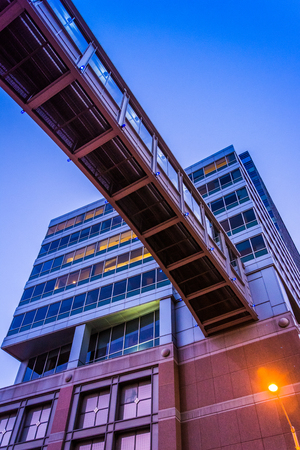 elevated walkway: Elevated walkway and modern building in downtown Baltimore, Maryland. Editorial