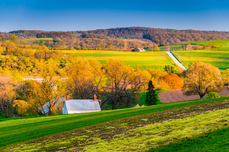Evening light on fields and hills in rural York County, Pennsylvania.