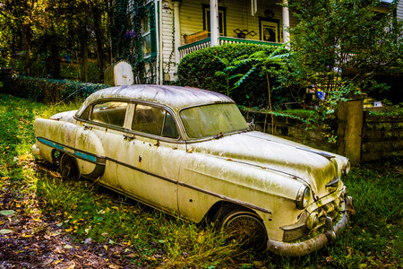 west virginia trees: Old car in front of a house in Harpers Ferry, West Virginia.