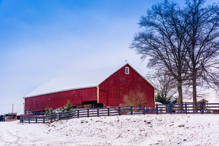 Red barn and snow-covered field in rural Adams County, Pennsylvania. Editorial