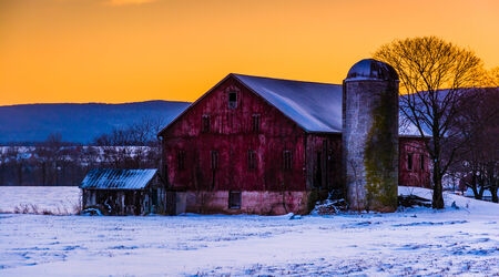 Winter sunset over a barn in rural Frederick County, Maryland. Editorial