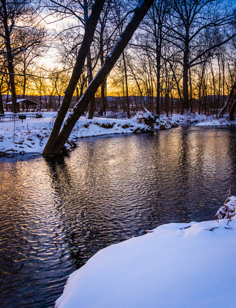 Winter view of a creek at sunset, in rural Frederick County, Maryland. Archivio Fotografico