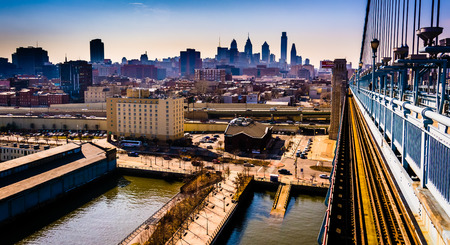 The Delaware River and skyline seen from the Ben Franklin Bridge Walkway, in Philadelphia, Pennsylvania.