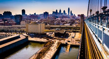 ben franklin: The Delaware River and skyline seen from the Ben Franklin Bridge Walkway, in Philadelphia, Pennsylvania.