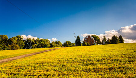Evening light on a house in a field, York County, Pennsylvania. photo
