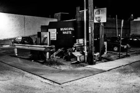 Trash in a parking lot at night in Hanover, Pennsylvania.