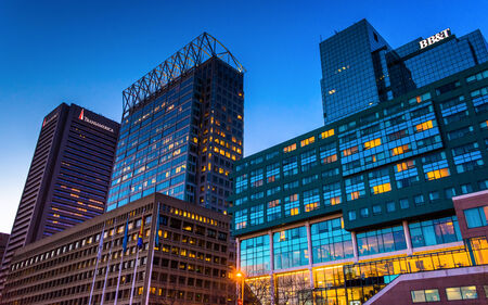 Buildings on Pratt Street at twilight, in Baltimore, Maryland.