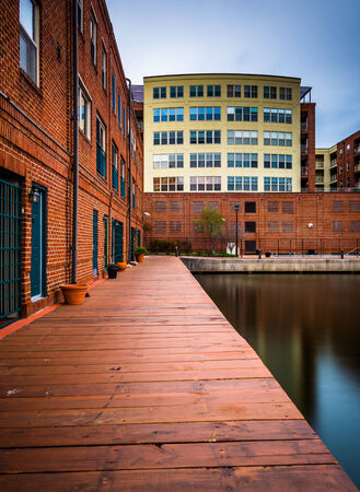 fells: Long exposure of buildings along the waterfront in Fells Point, Baltimore, Maryland.