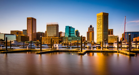 Long exposure of docks and the skyline at the Inner Harbor in Baltimore, Maryland.