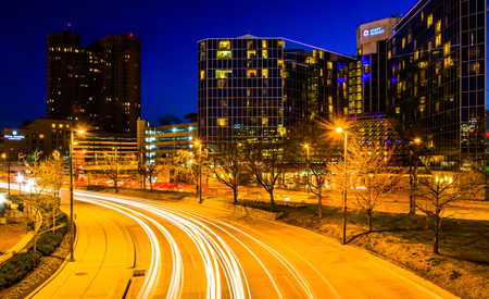 The Hyatt Regency and traffic on Light Street at night, in Baltimore, Maryland.