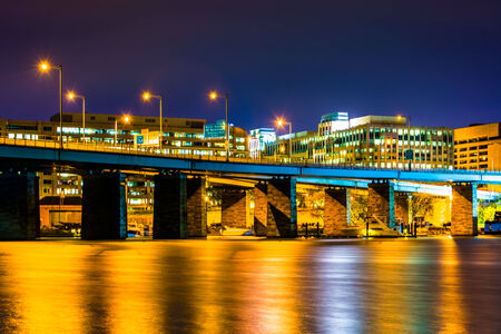 A bridge and buildings at night in Washington, DC. photo