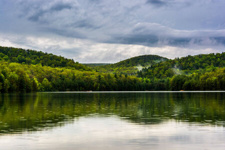 Clearing storm clouds over Long Pine Run Reservoir, in Michaux State Forest, Pennsylvania. Stock Photo - 28825879