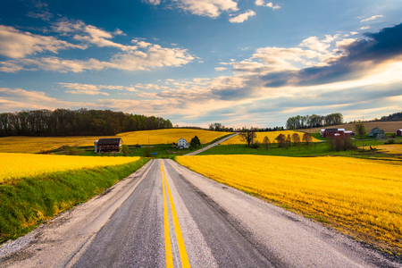 Country road through farm fields and rolling hills in rural York County, Pennsylvania. photo
