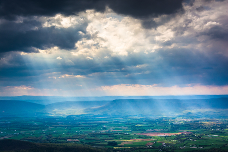 Crepuscular rays over the Shenandoah Valley, seen from Little Stony Man Mountain in Shenandoah National Park, Virginia. Stock Photo
