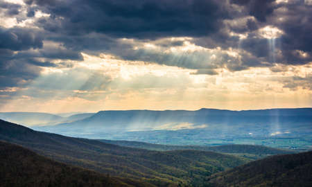 crepuscular: Crepuscular rays over the Shenandoah Valley, seen from Skyline Drive in Shenandoah National Park, Virginia. Stock Photo