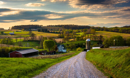 Dirt road and view of farm fields in rural York County, Pennsylvania. photo