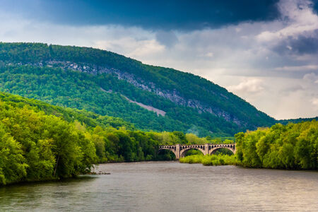 Mount Minsi and the Delaware River seen from from a pedestrian bridge in Portland, Pennsylvania. photo