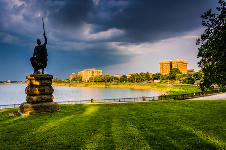druid: Storm clouds over a statue and Druid Lake at Druid Hill Park in Baltimore, Maryland.
