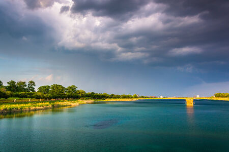 druid: Storm clouds over Druid Lake, at Druid Hill Park in Baltimore, Maryland.