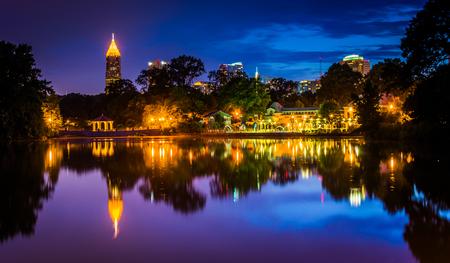 The Atlanta skyline reflecting in Lake Clara Meer in Piedmont Park in Atlanta, Georgia.
