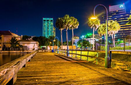 Pier and buildings at night in Jacksonville, Florida.