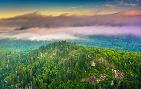 Low clouds over the Appalachian Mountains at sunrise, seen from Devils Courthouse, near the Blue Ridge Parkway in North Carolina. photo