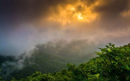 craggy: Sunset through fog, seen from Craggy Pinnacle, near the Blue Ridge Parkway, North Carolina.