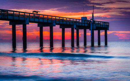 The fishing pier at sunrise, in St. Augustine Beach, Florida. photo