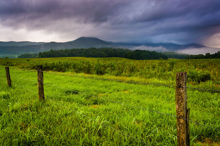 great smoky mountains national park: Fence in a field and low clouds over mountains at Cades Cove, Great Smoky Mountains National Park, Tennessee.