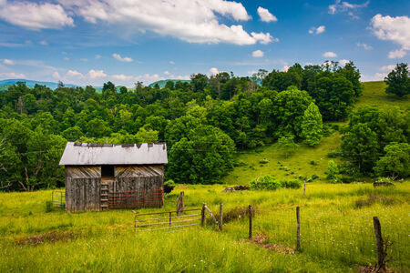 west virginia trees: Barn and fields in the rural Potomac Highlands of West Virginia. Stock Photo