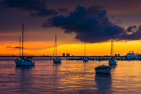 city of miami: Boats in Biscayne Bay at sunset, seen from Miami Beach, Florida.