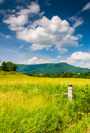 allegheny: Fence in a farm field and view of distant mountains in the rural Potomac Highlands of West Virginia. Stock Photo