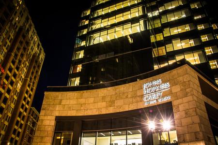 John Hopkins Carey Business School at night in Harbor East, Baltimore, Maryland.