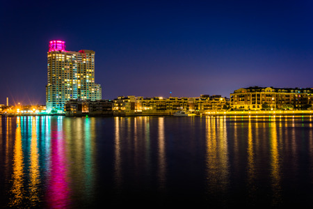 Waterfront condominiums at the Inner Harbor at night, seen from Harbor East, Baltimore, Maryland. photo