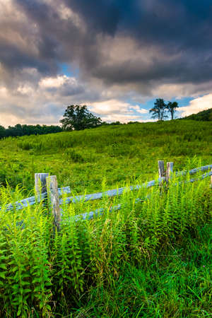 Fence and field along the Blue Ridge Parkway in North Carolina. photo