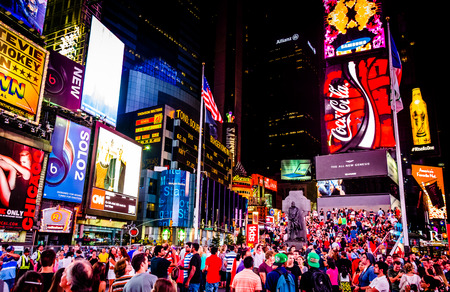 square: Large crowd of people in Times Square at night, in Midtown Manhattan, New York.