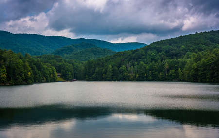 Storm clouds and mountains reflecting in Unicoi Lake, at Unicoi State Park, Georgia. photo