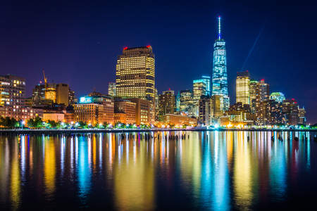 world trade center: One World Trade Center and Battery Park City at night, seen from Pier 34, Manhattan, New York.