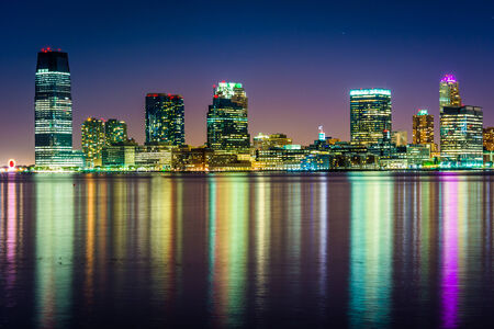 The Jersey City Skyline at night, seen from Pier 34, Manhattan, New York. photo