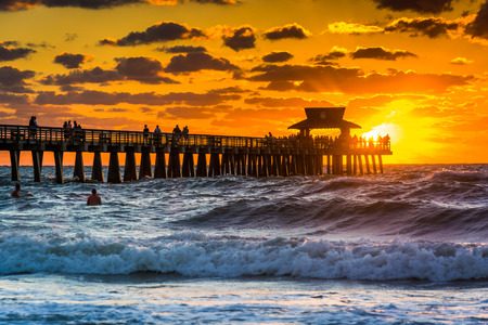 florida: Sunset over the fishing pier and Gulf of Mexico in Naples, Florida.