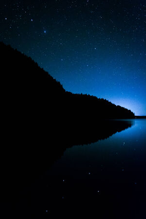 echo: Stars in the night sky reflecting in Echo Lake, at Acadia National Park, Maine.