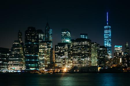 The Manhattan Skyline at night, seen from Brooklyn Bridge Park, Brooklyn, New York.