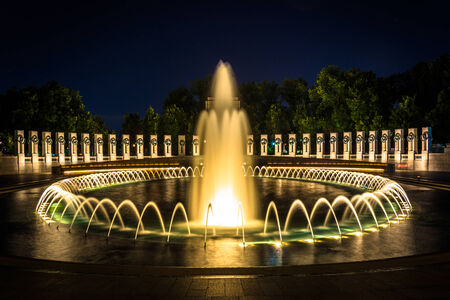 The National World War II Memorial Fountains at night at the National Mall in Washington, DC.