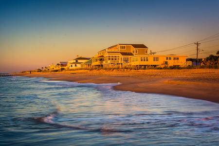 beachfront: Waves in the Atlantic Ocean and morning light on beachfront homes at Edisto Beach, South Carolina.