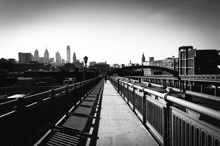 ben franklin: The Ben Franklin Bridge Walkway and skyline, in Philadelphia, Pennsylvania.