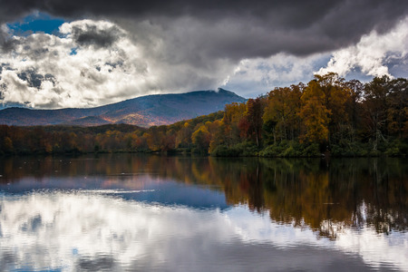 julian: Autumn color and reflections at Julian Price Lake, along the Blue Ridge Parkway, North Carolina.