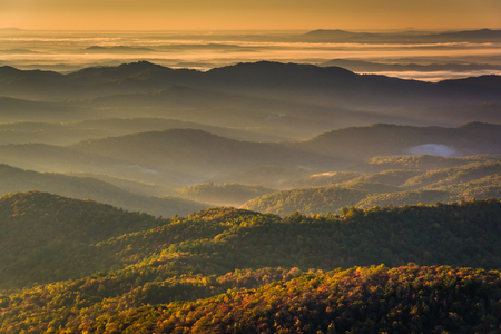 Sun shining through fog in the valley, seen from Beacon Heights, along the Blue Ridge Parkway near Blowing Rock, North Carolina. photo